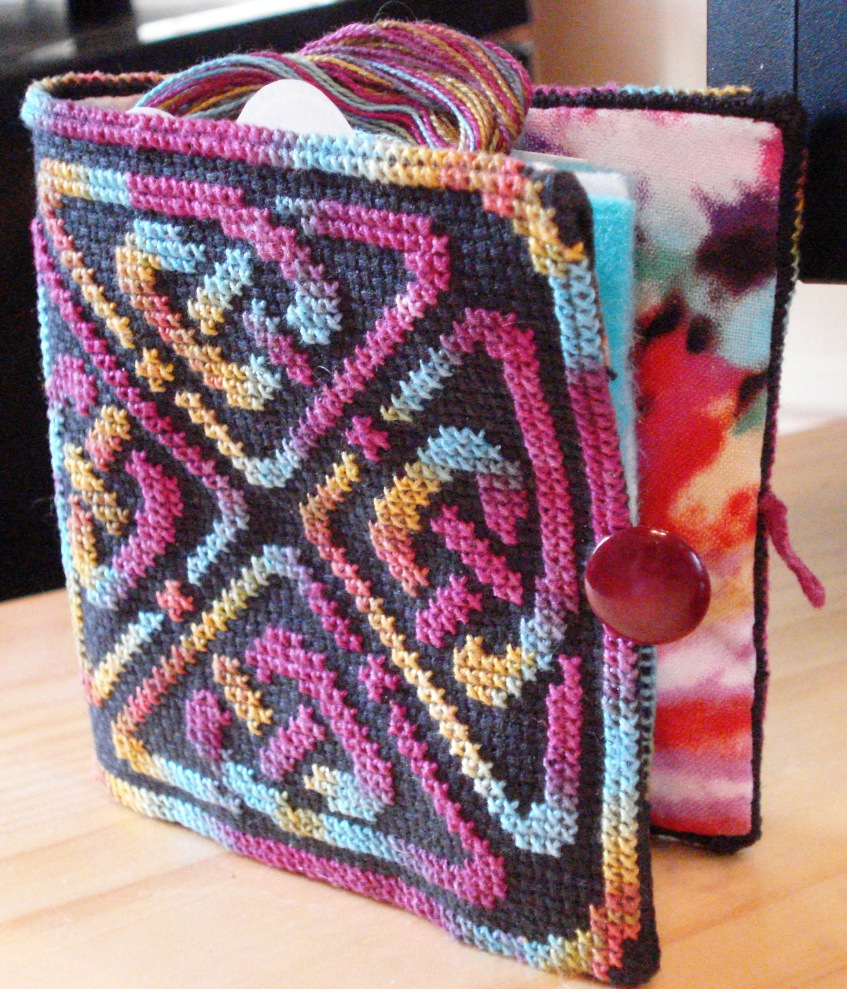 Needlebook cover, pattern Ink Circles stitched in Caron Waterlilies Cranberry